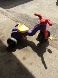 Toddler's purple, red, and yellow plastic trike