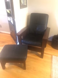"""Custom made leather chair with wooden arms and base.  Like New!  36"""" deep 34"""" wide 42"""" tall 45 km"""