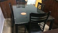 Black glass table with 6 black leather chairs  Fallsburg, 12763