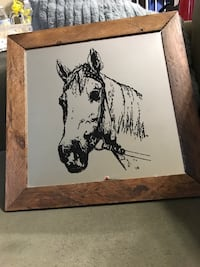 Mirror with a horse print on the mirror