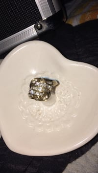 This ring is real has diamonds and baguettes through the middle and wrapped around the sides Logan, 08085