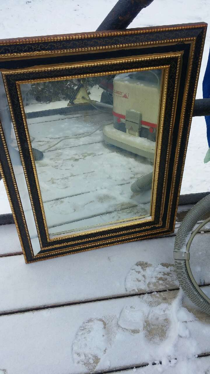rectangular mirror with black and brown frame