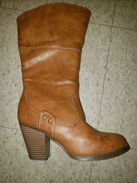 pair of brown leather cowboy boots Toronto, M6M 1T1