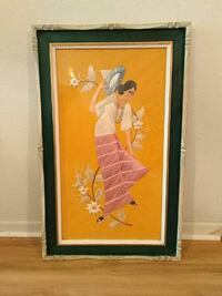 brown wooden framed painting of woman on traditional dress holding hat