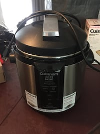 stainless steel and black Cuisinart slow cooker