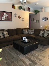 Black fabric sectional sofa with throw pillows and ottoman  North Las Vegas, 89030