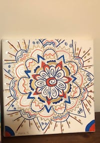 Mandala design with paint markers on square canvas