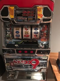 Tabletop slot machine with coins
