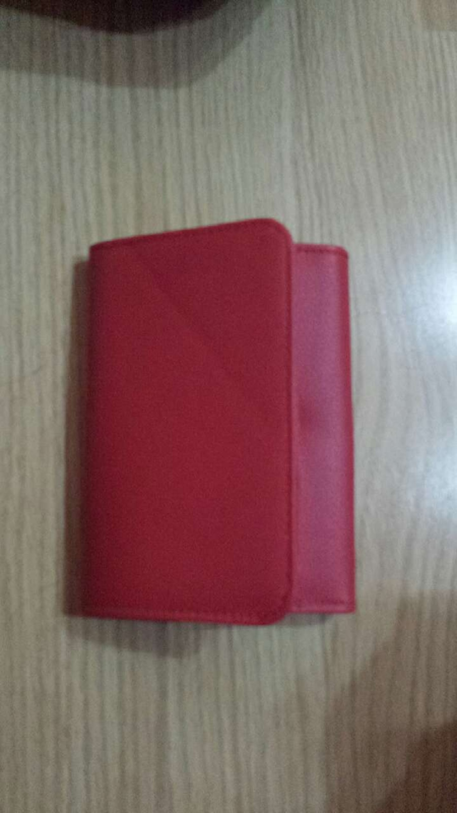 red leather trifold wallet