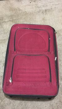 red and black travel luggage 517 km