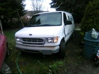 white Ford e250 with carpet cleaner