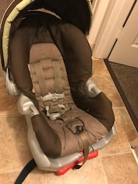 baby's brown and gray car seat