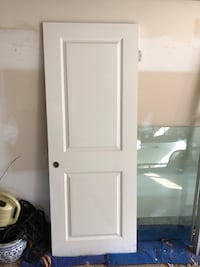 Two panel interior door (right hand) with hinges. Primed white.