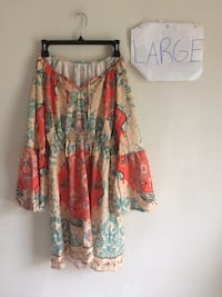 women's beige, blue, and red floral long-sleeved dress