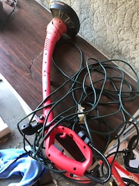 red and black corded power tool 1465 mi