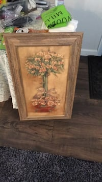 Brown wooden framed painting of flowers Great Neck, 11021