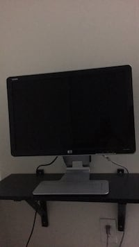 black HP flat screen computer monitor McLean