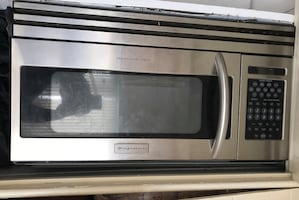 Silver frigidaire countertop microwave oven