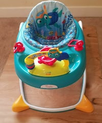baby's blue and white activity saucer