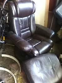 brown leather padded recliner with ottoman