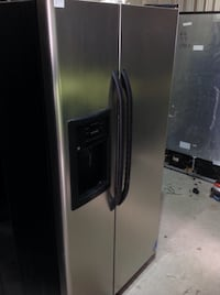 GE stainless steel side by side refrigerator  Houston, 77075