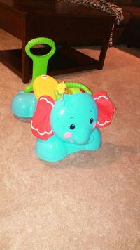 toddler's Fisher Price ride on toy