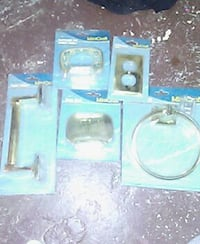 Gold bathroom accessories.  Brand new. Never opene
