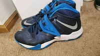 pair of blue-and-black Nike basketball shoes Columbus, 43228