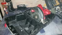 gray and red Skilsaw circular saw in case Montreal, H3G