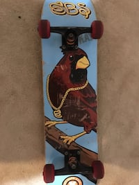 Red skateboard with cardinal on underside- Used and negotiable 36 km