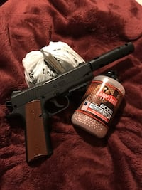 BB airsoft gun with open pack of Copperhead BBs and about 25-30 CO2 cartridges