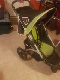 baby's green and black jogging stroller Surrey, V4N 3A2