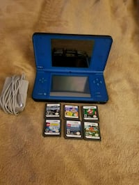 blue Nintendo DS with game cartridges Glenmont, 12077