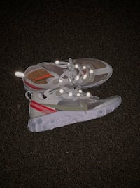 pair of gray-and-white Nike running shoes 26 mi