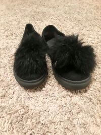 pair of black fur shoes 899 mi