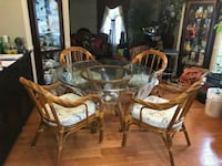 Glass table and four wicker dining chairs   Germantown, 20874