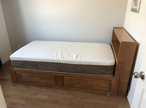 White and brown bed mattress