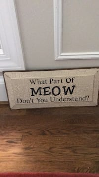 White and black wooden quote board meow cat sign