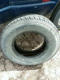 black auto tire with wheel 1784 mi