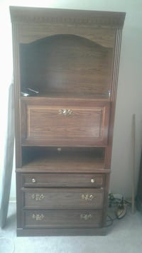 brown wooden rack with three-layer dresser