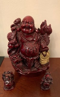 Three Burgundy wine colored Buddha's