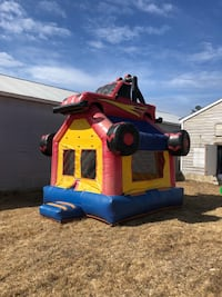 Monster truck bounce house. Excellent condtion. Comes with blower