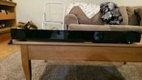 brown wooden framed glass top coffee table McHenry, 60051