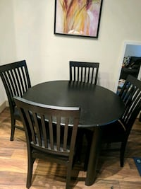 round brown wooden table with four chairs dining set Houston, 77057