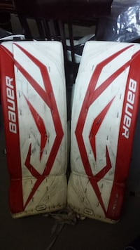 white-and-red Bauer cricket shinguard