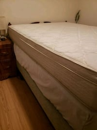 brown wooden bed frame and white mattress Vancouver, V6G 2R7
