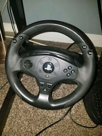 black ps4 steering wheel and 2 games Surrey, V3W 0W8