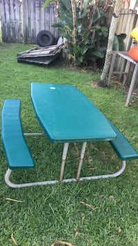 Green and white picnic table