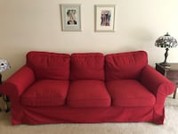Comfy red couch with washable cover