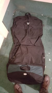 black and gray suit bag